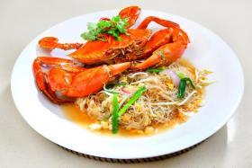 Xian Seafood Village's crab beehoon is a popular dish.