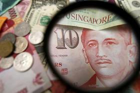 Singdollar strengthens as US dollar takes a battering