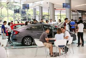 Brisk sales as COE premiums fall