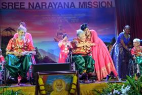 Sree Narayana Mission Nursing Home resident Tan Geok Kuan (centre) performing during the mission's celebrations on 10 September 2017, to mark 163 years since Indian philosopher Sree Narayana Guru's birth. The nursing home in Yishun is one of the 58 places around Singapore that served as go-to points, where people who cannot remember where they live can be taken to by members of the public.