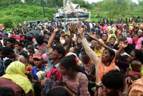 Rohingya refugees scuffling for relief supplies at a refugee camp in the Bangladeshi locality of Ukhia on Saturday.