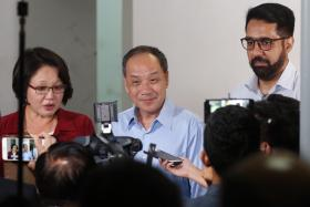 Workers' Party chief Low Thia Khiang, party chairman Sylvia Lim and assistant Secretary-General Pritam Singh holding a media doorstop interview on the Aljunied-Hougang Town Council lawsuit on 26 July 2017