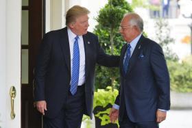 Mr Donald Trump greeting Mr Najib Razak at the White House on Tuesday.