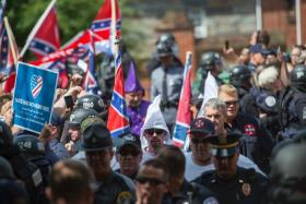 Members of the Ku Klux Klan arrive for a rally, calling for the protection of Southern Confederate monuments, in Charlottesville, Virginia on July 8, 2017.