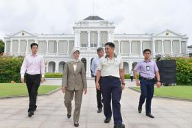 Madam Halimah Yacob touring the grounds in the Istana with (from far left) Principal Private Secretary to the President Benny Lee; head of Istana Programmes and Household Sunny Seah; and NParks group director (Fort Canning and Istana) Wong Tuan Wah.