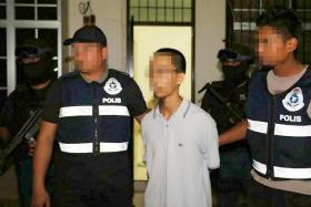 Malaysian police arresting a 21-year-old who admitted to receiving guidance from top ISIS fighters to make bombs in Bagan Serai, Perak.