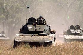 The Bionix IFV (Infantry Fighting Vehicle), seen here in a technical firing exercise in the Shoalwater Bay Training Area, Australia on Aug 3, 2011