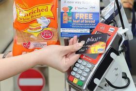 More cashless payment schemes could lift local banks' profits