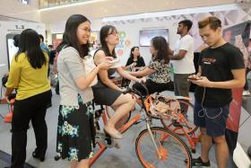 Visitors at the One Raffles Place roadshow can get a $10 promo code and a free towel if they cycle for a minute at the Mobike counter.