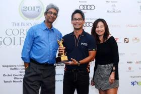 Ivan Chua (centre), the FJ Player of the Round, after receiving his trophy from FJ representative Sally Chua (right). On the left is Business Times News Editor Ven Sreenivasan.