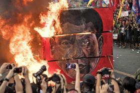 Activists burn an effigy during a protest against Philippine President Rodrigo Duterte near the presidential palace.