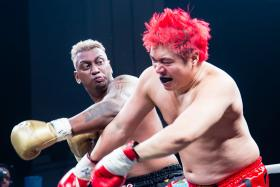 Pradip Subramanian fighting Steven Lim during the Asia Fighting Championship match at Marina Bay Sands