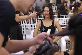 Contestants prepare their hair for the crown
