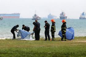 Police officers retrieving the body of Muhammad Suhaimi Sabastian, 12, who was found in the waters off Bedok Jetty on 8 May 2017 after a search operation that lasted three hours. He was reported missing in the waters off East Coast Park after an outing that went awry.