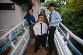(From left) Kristina Liu, 30, Lee Ci En, 21, and Joshua Tang, 20, received the Asia Pacific Breweries Foundation Scholarship for Persons with Disabilities yesterday.
