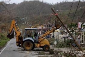 Many Puerto Ricans have started their own clean-up operations with the help of generators, after the US territory was hit by Hurricanes Maria and Irma.