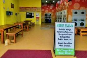 """Muslim-only launderette owner apologises, will obey Johor Sultan's decree to remove signboard The matter first came to light when a photo, believed to have been taken at the launderette, showing an """"Only For Muslims"""" sign went viral on social media."""