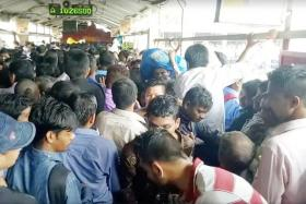 Commuters at the Elphinstone Road station bridge in Mumbai.