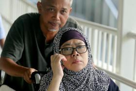Zariah Mohd Ali (on wheelchair) and her husband Mohamad Dahlan.