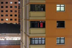 The flat (centre, with dim red light) in Jurong West Street 61 where a brothel operates. Residents said that for the last one year, the rented unit has housed a number of foreign women.