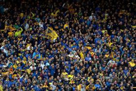 Boca Juniors fans cheering on their team against Chacarita Juniors in the Argentina First Division Superliga match at the La Bombonera stadium in Buenos Aires on Sunday.