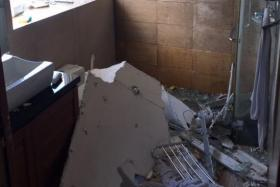 The aftermath of an explosion caused by an electric storage water heater in the en-suite bathroom in a condominium unit at Cote D'Azur in Marine Parade on 30 September