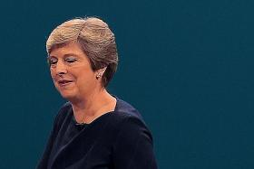 May has backing of senior ministers despite rebellion