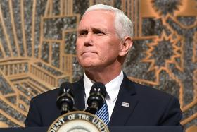 Pence stresses unity at shooting commemoration