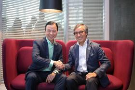 Starhub chief executive Tan Tong Hai (left) and OCBC chief operating officer Ching Wei Hong.