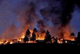 Smoke and flames rising from buildings in Sonoma County, California.