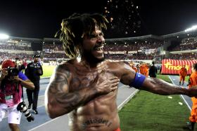 Panama's Roman Torres celebrates after scoring a goal against Costa Rica.