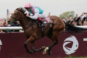 Jockey Frankie Dettori securing his record fifth Prix de L'Arc de Triomphe victory aboard Enable earlier this month.