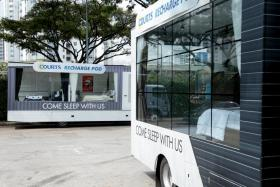 Two of Courts' Recharge Pod trucks.