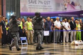 """Police specialist officers responding to the """"threat"""" at Terminal 3."""