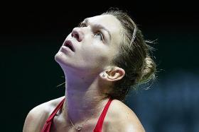 Halep thrashed by Wozniacki
