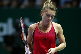 Halep crashes out of WTA Finals