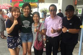 Sungei Road vendors show Singapore Poly students their sales techniques