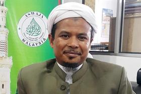 Malaysian minister urges Muslim preacher to 'keep his mouth shut'