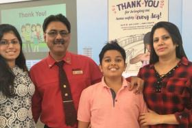 Mr Charnjit Singh (second from left) and his family.