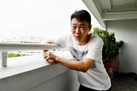 Neighbours save man dangling from corridor railing