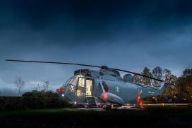Royal Navy ZA127 Sea King helicopter on a farm in Stirling, Scotland, by Helicopter Glamping.