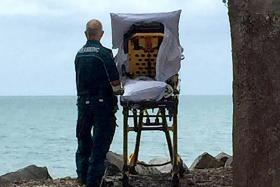 Paramedics helping a palliative care patient fulfil her final wish, to visit the beach.