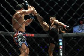 Singapore's Amir Khan (right) believes he is ready for a shot at One Championship's lightweight world title, after his convincing victory over 43-fight veteran Adrian Pang.