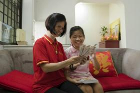 Miss Tan Xing En (with her mother) was diagnosed with retinitis pigmentosa when she was around three.