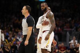 Cavaliers survive James' first career ejection