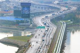 Malaysia's Vehicle Entry Permit to be delayed, says transport minister