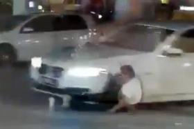 Screengrab from a video showing a white BMW hitting the victim at a Shell petrol station in Jalan Sri Pelangi, near the JB customs complex.