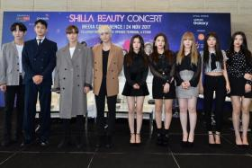 Kim Jong Hyun (above in brown) in Singapore on Nov 24 with fellow Shinee members and girl group Red Velvet.
