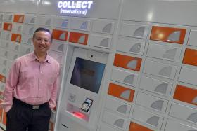 NLB chief information officer Lee Kee Siang with one of the reservation lockers at a library.