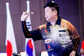 Singaporean darts player Paul Lim stuns former world champion